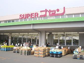 (有)小専商店